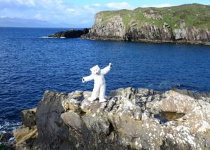 Beary The official mascot of Mascot Ambassadors poses on the Atlantic cliffs in Ireland