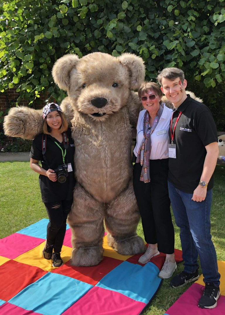 Giant Teddy Mascot Bentley the Bear with support crew and Diane Harrison WhizzFizzFest Event