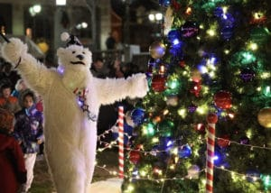 Polar Bear, Reindeer mascot characters at Christmas lights switch on events