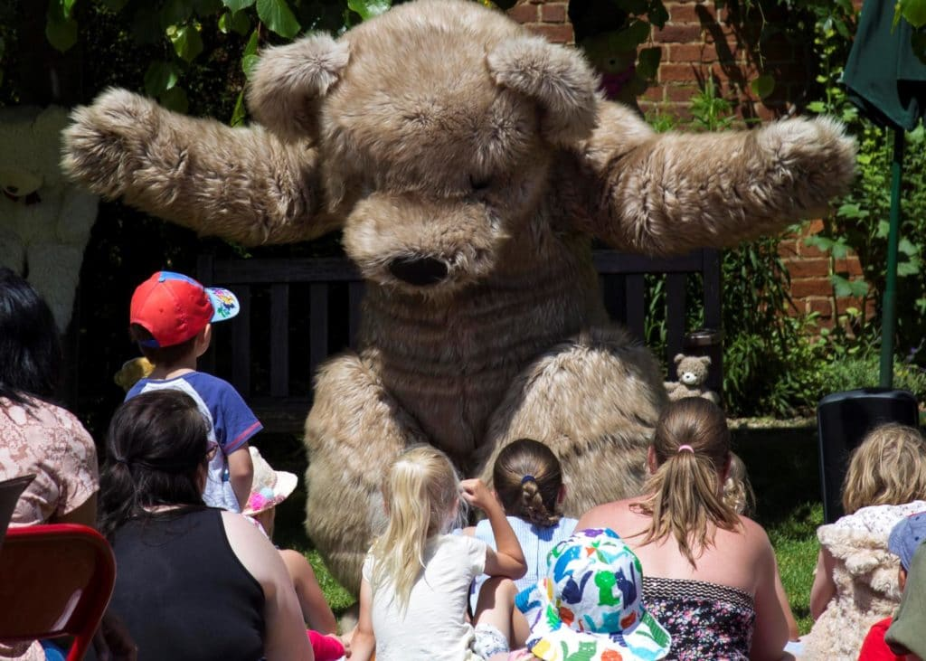 Giant Teddy Mascot Bentley the Bear acting during story time at the annual WhizzFizzFest Event