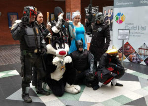 Group photo with Sylvester the Cat mascot during Comic Con