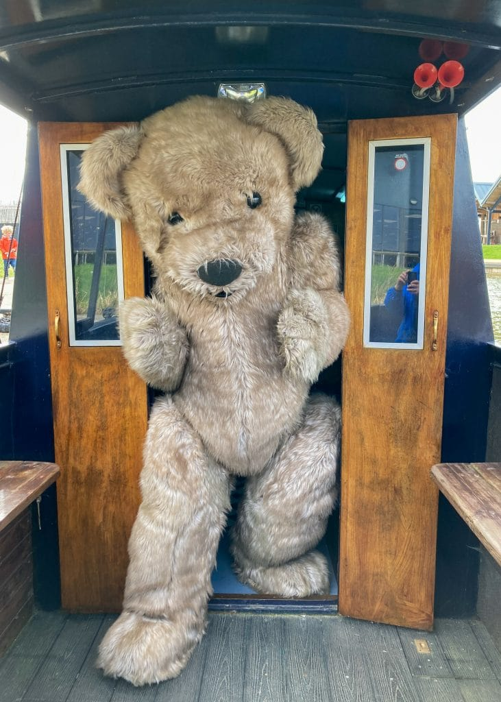 Giant teddy bear costume, Bentley the Bear exiting the boat